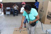 A woman votes in Ecuador's 2017 presidential election.