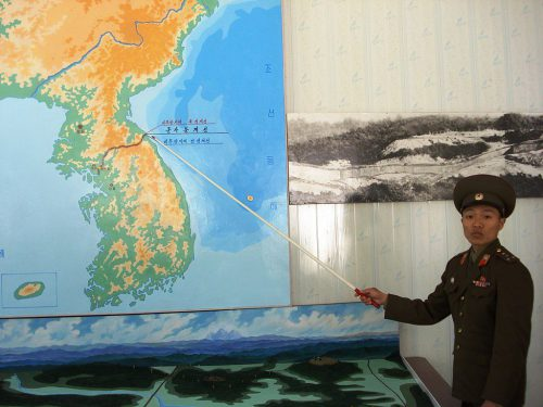 North Korean Soldier showing border between North and South Korea.
