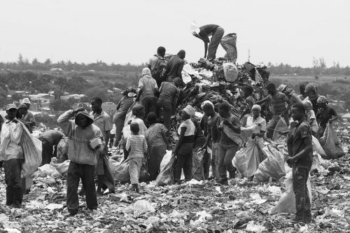 People going through trash at the Hulene dump in Maputo in 2014.