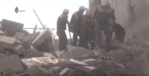 The White Helmets, a rescue group, look for hurt people.