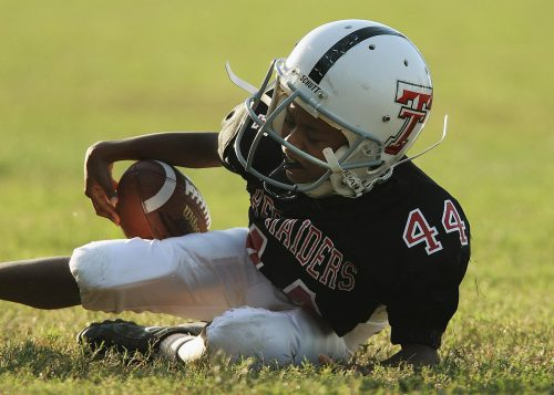 Fallen youth football player.