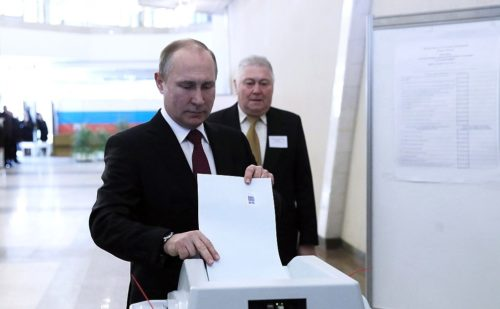 President Vladimir Putin votes in yesterday's presidential election.