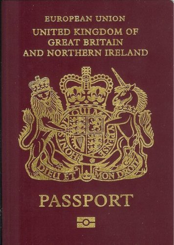 UK passports are dark red now and show that the UK is part of the European Union.