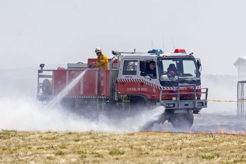 NSW firefighters extinguishing a small grass fire at Wagga Wagga Airport in 2014.