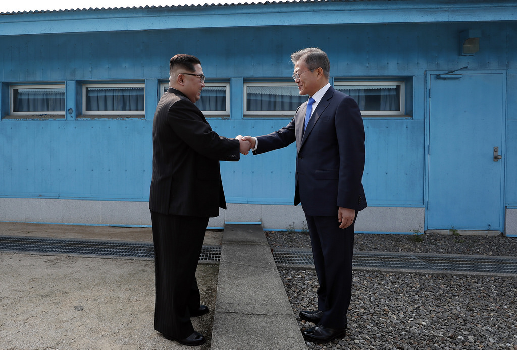 President Moon Jae-in greets Kim Jong-un, the leader of North Korea, at the border between the two countries.