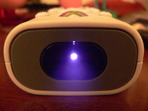 TV remote, showing infrared LED lit up.