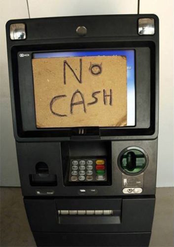 "ATM with ""No Cash"" sign."
