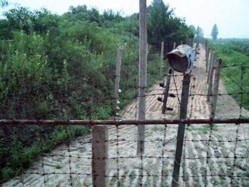 The countries are protected from each other by barbed wire and electric fences.