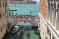 Tourists crowd the bridges of Venice.
