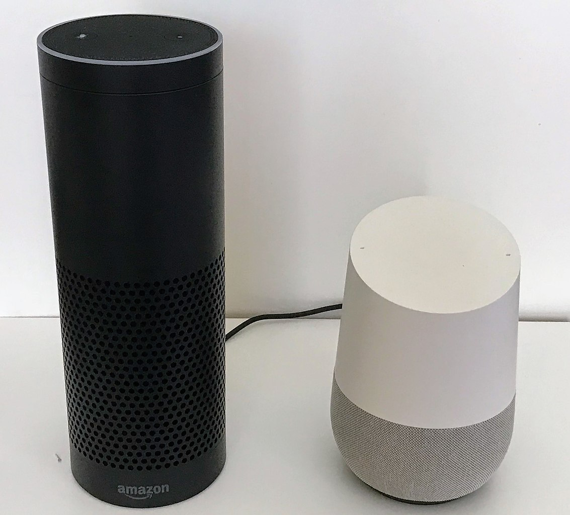 """Amazon's Echo Plus (left) and Google's Google Home are examples of """"smart speakers""""."""
