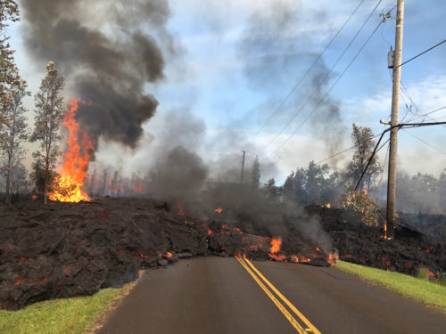 Lava flows over the road in Lailani Estates.