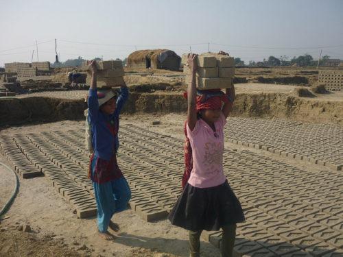 Girls working in brick factory in Nepal.