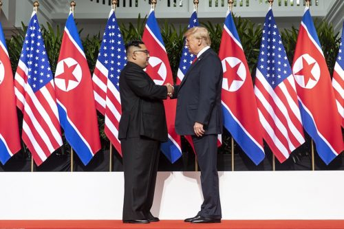 Mr. Kim and Mr. Trump shaking hands at the red carpet during the Singapore Summit.