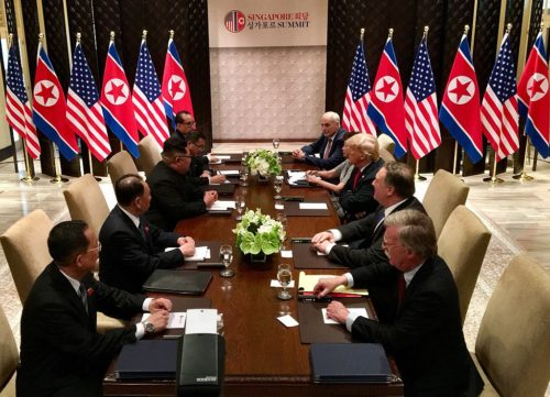 Mr. Trump and Mr. Kim meeting with teams of helpers.