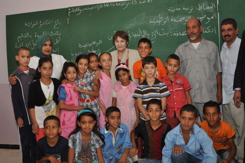 Nouria Benghabrit (back, center) is in charge of education in Algeria.In this picture, she is visiting a primary school.