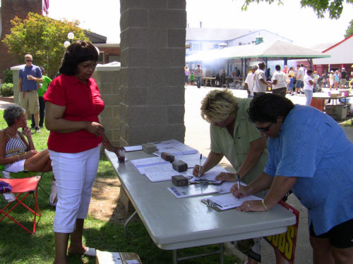 People collecting signatures.