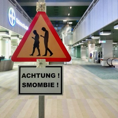 "Achtung! Smombie! (""Caution! Smombie!"") This sign in Germany warns people to look out for ""smartphone zombies""."