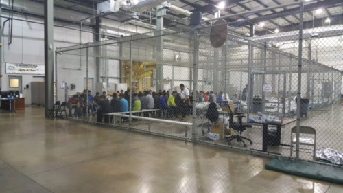 Government workers deal with immigrants in large buildings like this one in Texas.