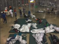 The US government is keeping some of the children in large cages in a big building.
