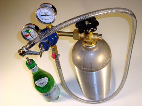 Carbon dioxide is usually stored in tanks like the one below.The gas is then added to drinks.