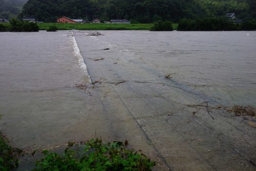 Flood waters cover a bridge in Japan.