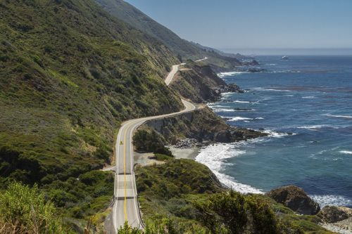 Highway 1 runs along cliffs above the ocean near Big Sur, California.