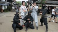 People dressed from the ninja time period at the theme park, Edo wonderland, in Japan.