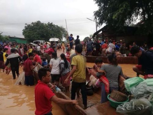 Lao News Agency photo of people fleeing flood.
