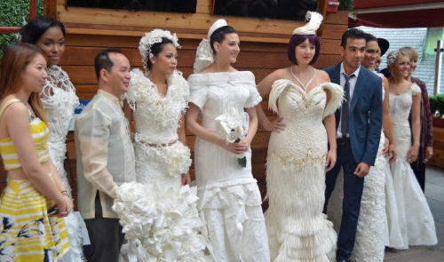 Some of the toilet paper dress creators with their models.