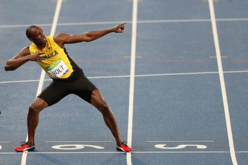 "Usain Bolt doing his famous ""lightning bolt"" move."