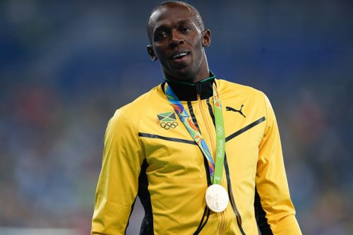 Bolt with gold medal in the 2016 Olympics.