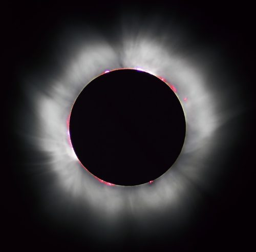 This picture was taken during a solar eclipse. The sun is blocked out, but you can see the corona.