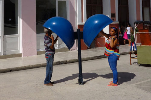 People using Cuban pay phones.