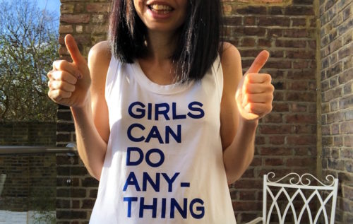 """Dr. Jess Wade wearing a t-shirt that says """"Girls Can Do Anything""""."""