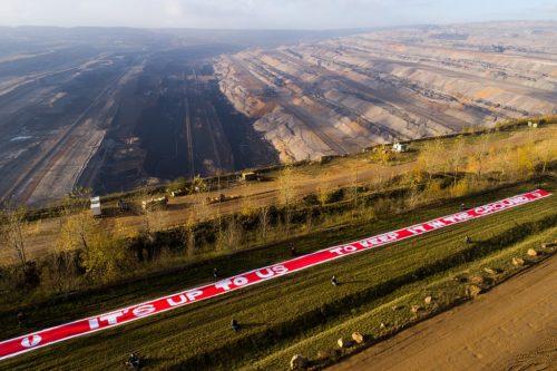 """Jugendnetzwerk für politische Aktionen unfolded a huge banner in the Hambach lignite mining pit, 2017 – """"It's up to us to keep it in the ground."""""""