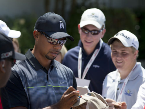 Tiger Woods signs autographs at the Quicken Loans National golf tournament at Congressional Country Club on June 24, 2014 in Bethesda, Maryland