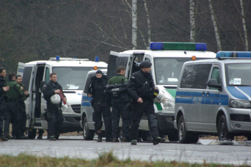 Police near vans outside Hambach Forest.
