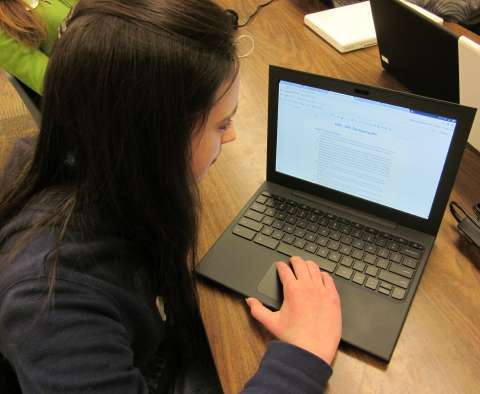 Student using Google apps on a Chromebook.
