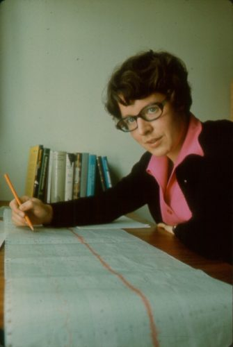 Dr. Jocelyn Bell Burnell studying a long paper chart.