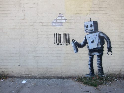 "Graffiti of a robot spray painting a graffiti of a bar code from Banksy's ""Better Out Than In"" October 2013 New York City residency."