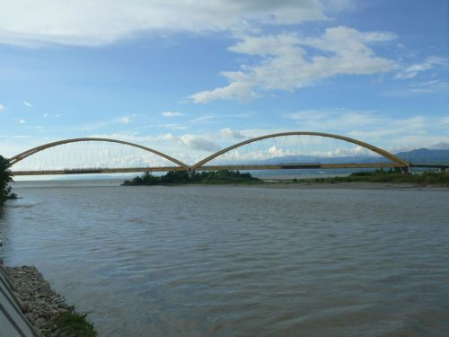 Image of arched bridge in Palu, Indonesia.
