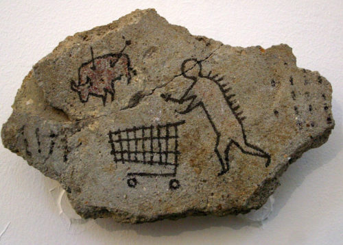 Banksy's fake cave painting of a early human with a shopping cart.