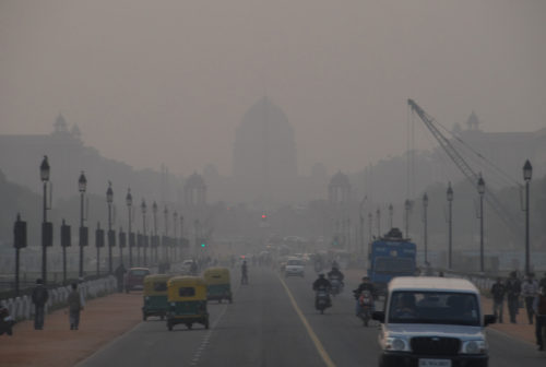 Smog in Delhi, looking down busy street