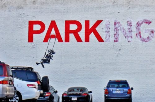 "Banksy turned this ""Parking"" sign into a sign that simply said ""Park"" and showed a girl on a swing."