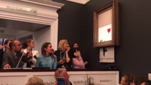 Screenshot of YouTube video by Banksy showing people reacting as painting shreds itself.