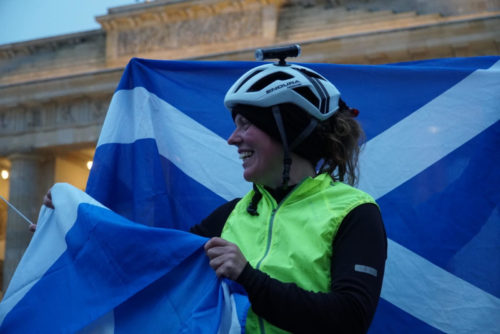Jenny Graham with flag at the Brandenburg Gate
