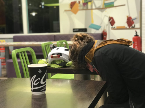 Ms. Graham asleep with her head down on the table in McDonald's.