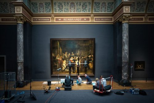 Experts examine Rembrandt's The Night Watch.