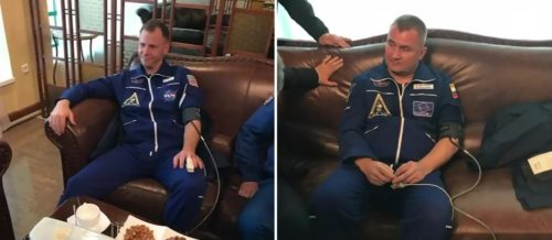 Nick Hague (left) and Aleksey Ovchinin (right) wearing blood pressure cuffs and pulse oximeters in Jezkazgan following their safe landing
