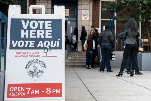 Sign saying: Vote Here, Vote Aqui